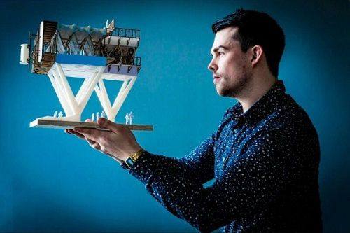 Thomas Cox, Wotton Donaghue Architects, with a model of the Sky Farm (credit Wotton Donaghue)