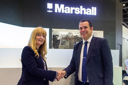 Marshall Chief Executive Officer Kathy Jenkins and Ian Muldowney, Chief Operating Officer, BAE System's Air Sector celebrate Tempest partnership announcement on Marshall's stand at DSEI.