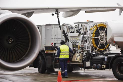 Image: Airline maintenance workers carry out operational checks. Staff in these environments require robust devices protected against hazardous weather conditions and capable of providing clear audio in noisy environments.