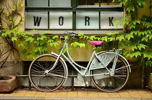 bicycle and sign saying 'Work' - Image by Free-Photos from Pixabay