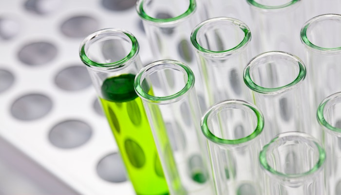 test tubes - one containing green liquid