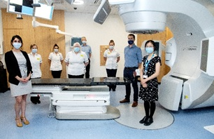 The radiotherapy team with June Dean (centre) and Tara Djanani from BrainLab (left).