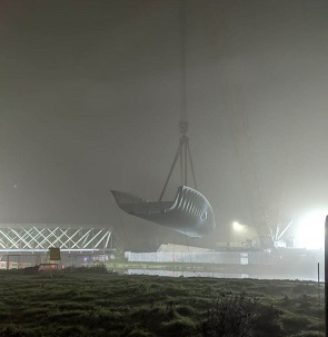 Bridge being hoisted by crane