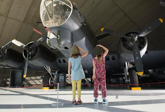 children looking up at plkance at IWM Duxford