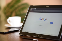 A laptop screen showing Google search engine