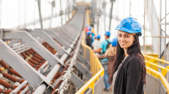 Girl in a hard hat on a building site