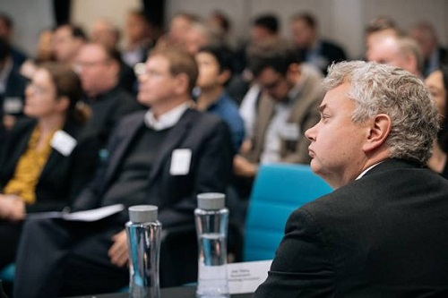 Last year's CVD judge and attendees listening to a pitch