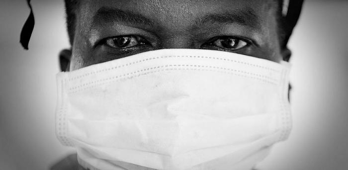 Doctor with face mask in the Fight Against Ebola in Sierra Leone  Credit: Defence Images