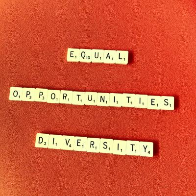 scrabble tiles spell out equal opportunities/ diversity