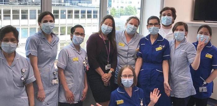 Estee Torok (centre, in black) with team at Addenbrooke's Hospital  Credit: Estee Torok