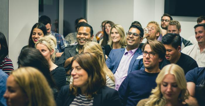 a crowd of people at a face to face event