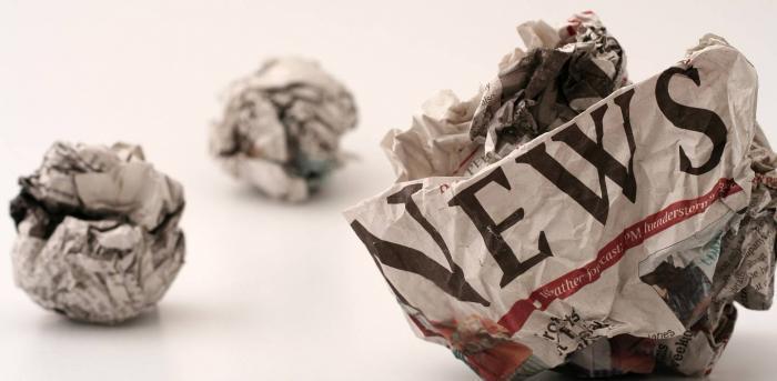 screwed up pieces of newspaper