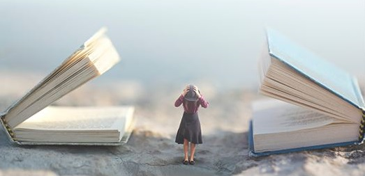 miniature woman between two large books _Image copyright: Cristina Conti