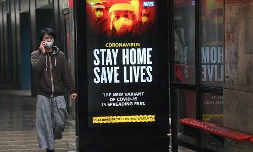 Stay home/ save lives sign in a city centre  Neil Hall/EPA-EFE