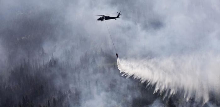 US National Guard working to extinguish wildfires in Alaska  Credit: Balinda O'Neal