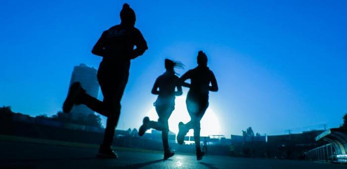 Silhouettes of three women running  Credit: Fitsum Admasu