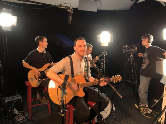 The band Datum Plane being filmed while they perform one of their songs at Cambridge TV