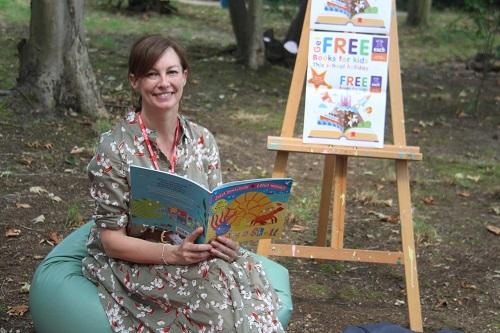 woman holding children's book
