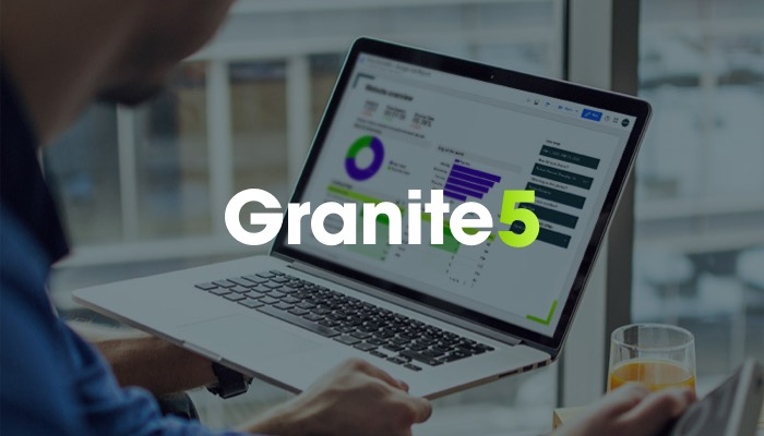 person sitting at a laptop_Granite 5 banner