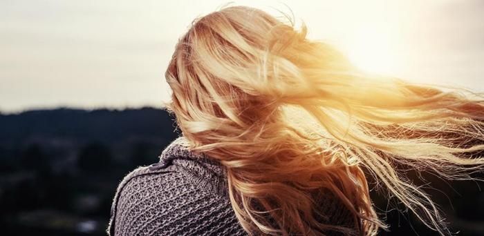 Girl seen from behind with hair blowing in the wind_Image credit: Pixabay