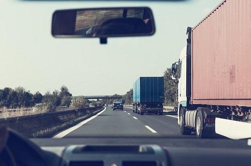 Trucks on the highway -- Image by Markus Spiske from Pixabay