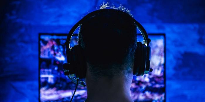 silhouette of gamer with headphones on