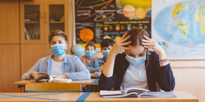 Students in a classroom wearing face masks