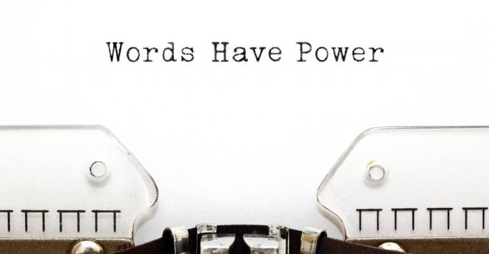 typewriter with 'words have power' written on its inserted paper