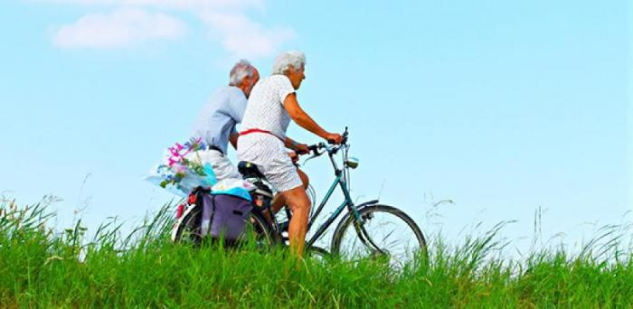 A couple cycling  Credit: MabelAmber