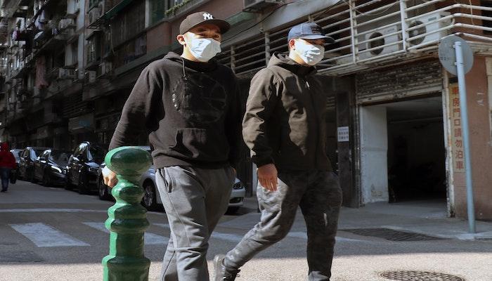 Two men wearing face masks