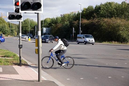 Cyclist crossing Madingley Road in Cambridge