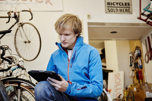 man with bicycles and paperwork