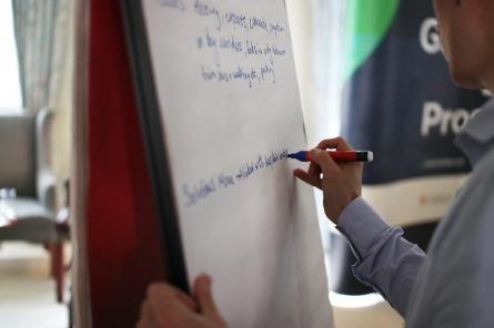 Man writing on flipchart