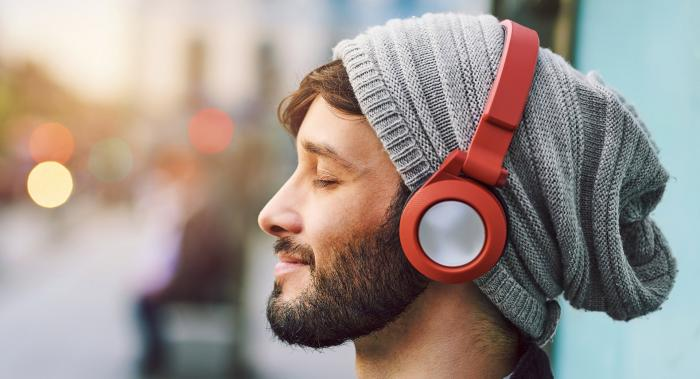 man in a hat wearing red headphones