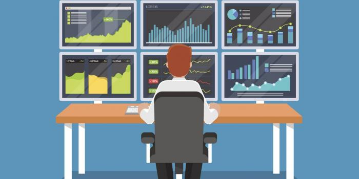 illustration of person sitting in front of sveral computer screens