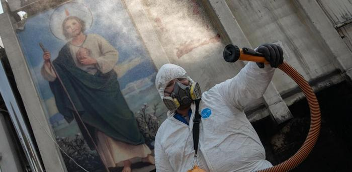 Sanitising a public space in Mexico Credit: Eneas De Troya