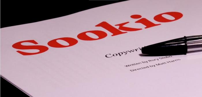 Printed pages of script with Sookio's logo