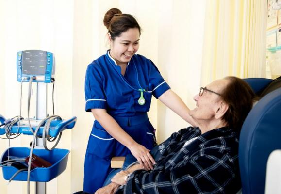 Nurse chats to patient