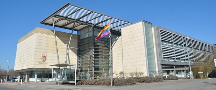 SCDC building with rainbow flag
