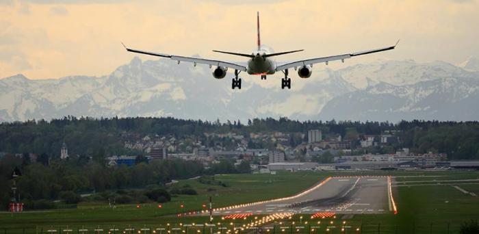 Plane landing in Zurich  Credit: Photo by Pascal Meier on Unsplash
