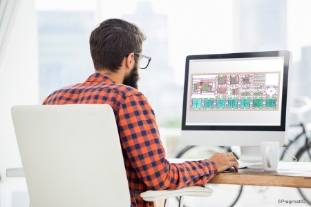 Man at computer using PragmatIC's FlexIC Foundry™ platform