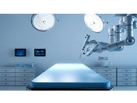empty operating table wirth robotic surgery arm in view above it
