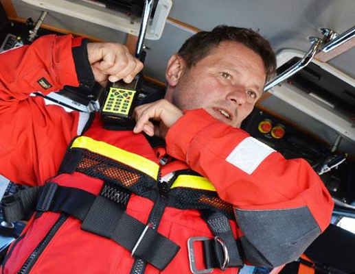 A volunteer for Swedish Sea Rescue Society with his Sepura STP9000 terminal.