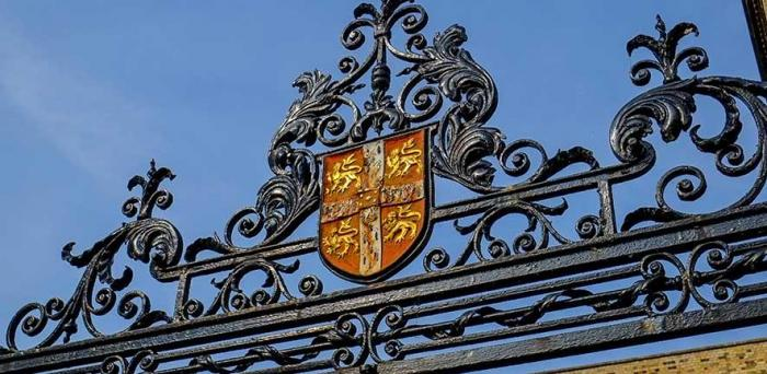 University coat of arms/ shield  on iron gate
