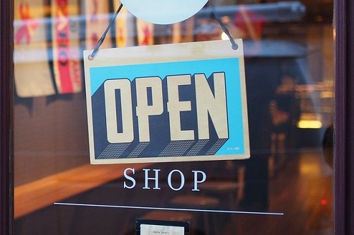 shop door with Open sign/ Image by StockSnap from Pixabay