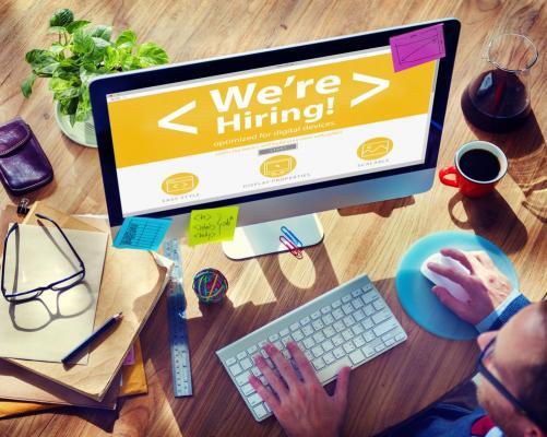 Laptop screen saying 'We're hiring!'