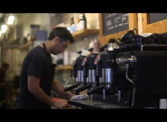 A video still showing a man making coffee