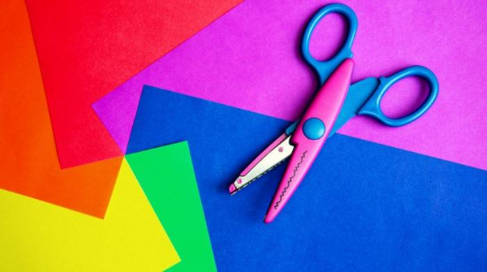 scissors sitting on pieces of coloured paper