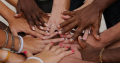 many hands connecting in a circle