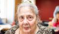 elderly lady looking into camera
